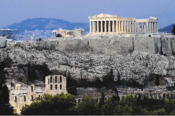 The ruins shown in this photo are from the Parthenon, a beautiful temple built to celebrate a Greek victory in war. It is a very large structure built on the top of a hill. It is made of stone and features massive columns. Credit: © Anders Blomqvist/Lonely Planet Images